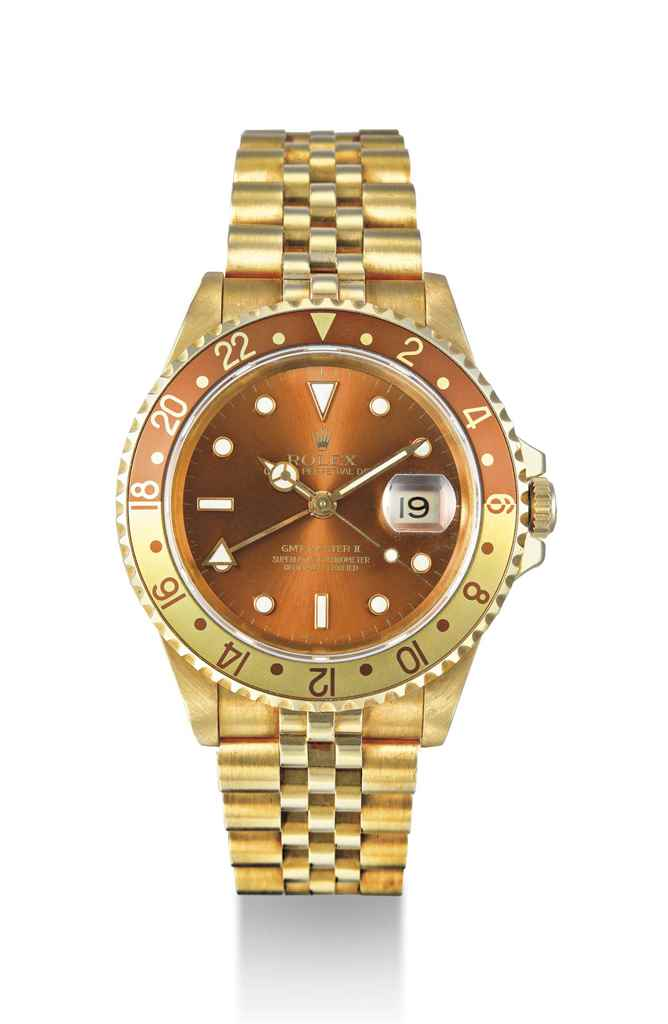 ROLEX. AN 18K GOLD AUTOMATIC D