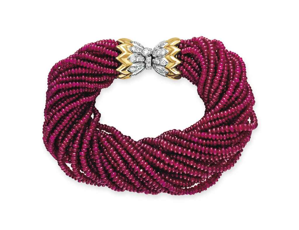 A RUBY BEAD AND DIAMOND BRACEL