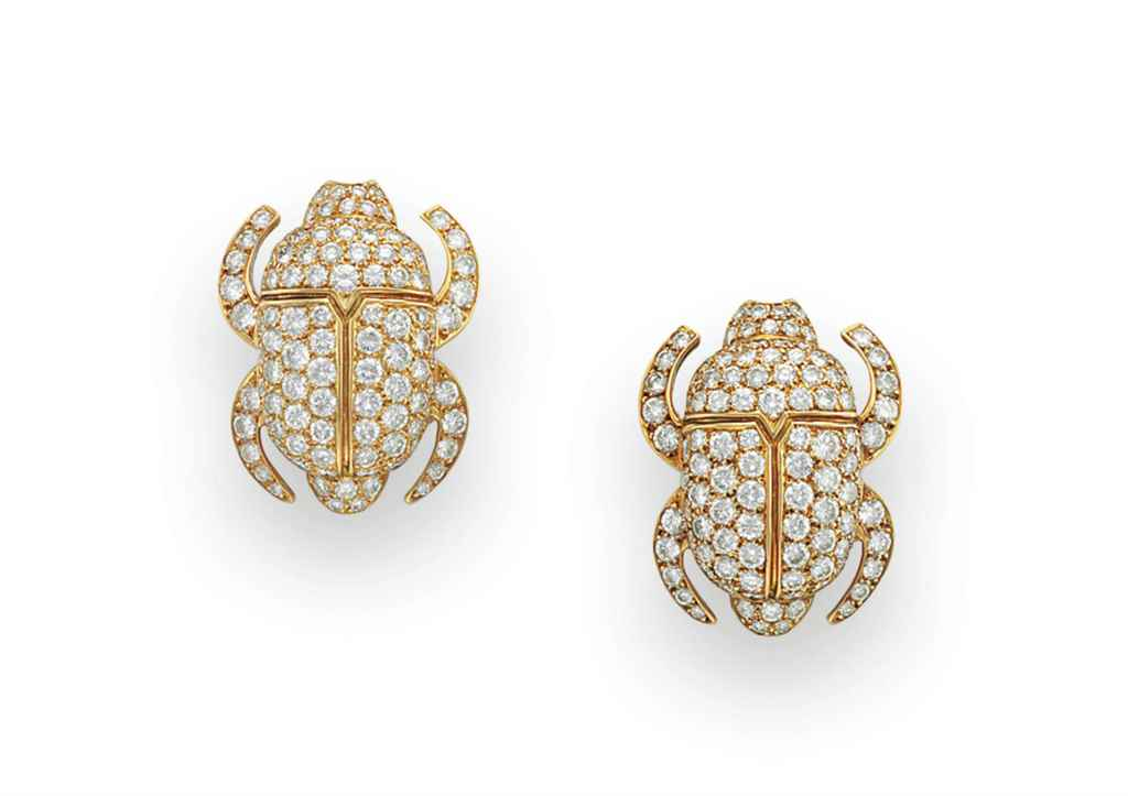 A PAIR OF DIAMOND SCARAB EAR C