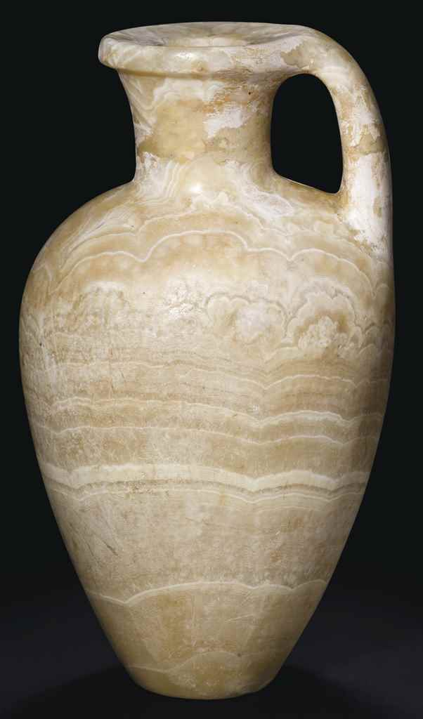 AN EGYPTIAN BANDED ALABASTER J