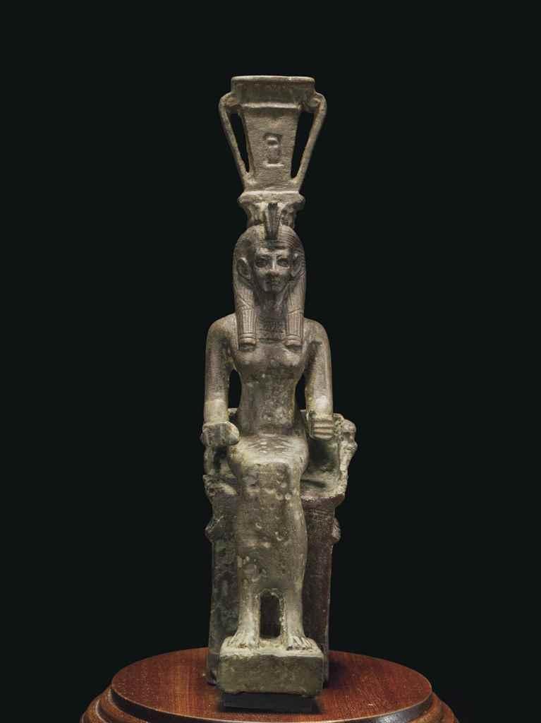 AN EGYPTIAN BRONZE ENTHRONED H