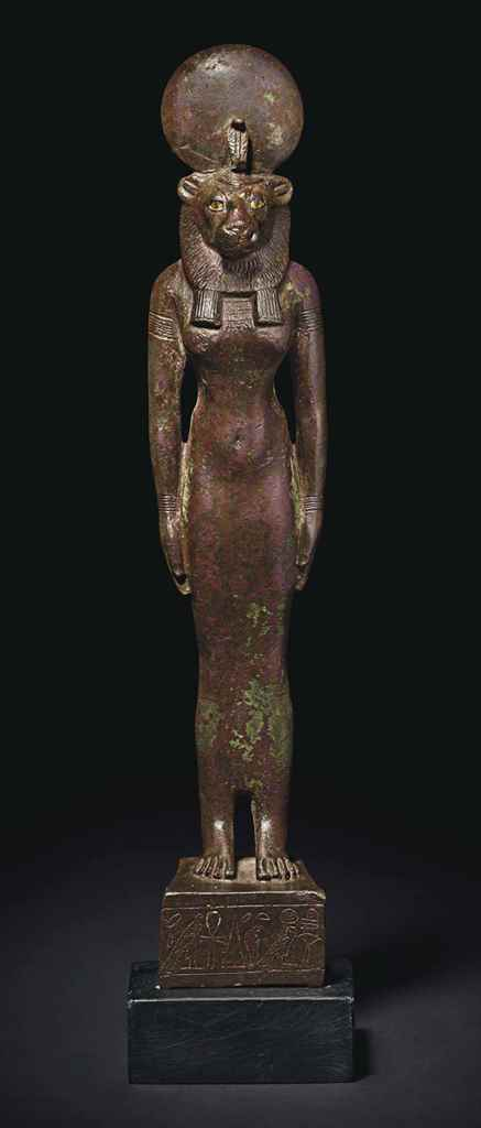 AN EGYPTIAN BRONZE SEKHMET