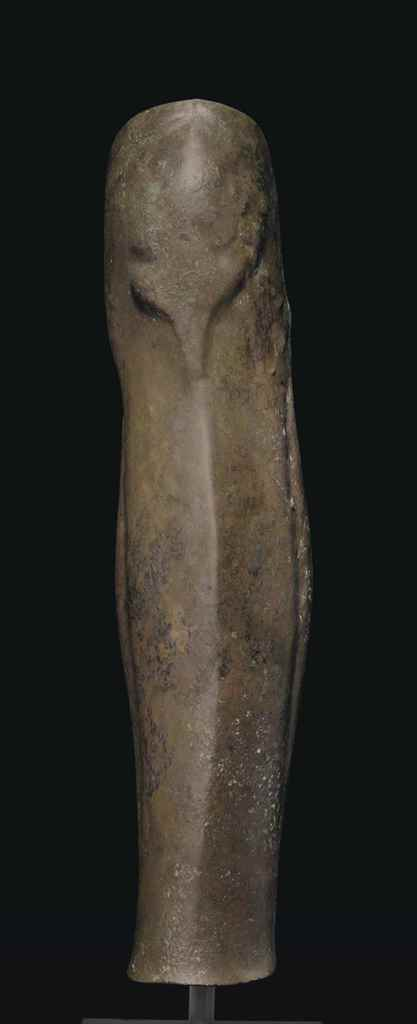 A GREEK BRONZE GREAVE