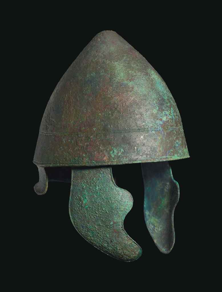 A GREEK BRONZE PILOS HELMET WI