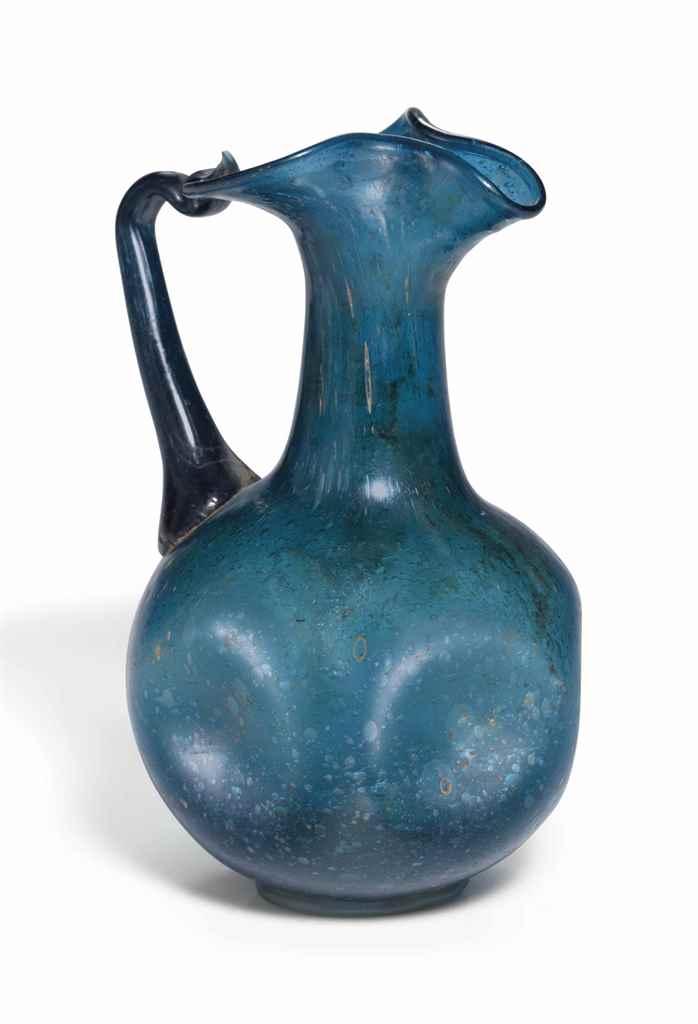 A ROMAN BLUE GLASS JUG