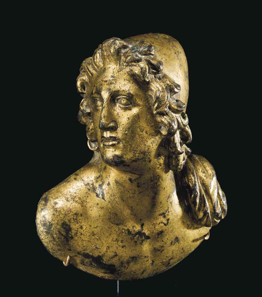 A ROMAN GILT-BRONZE BUST OF A