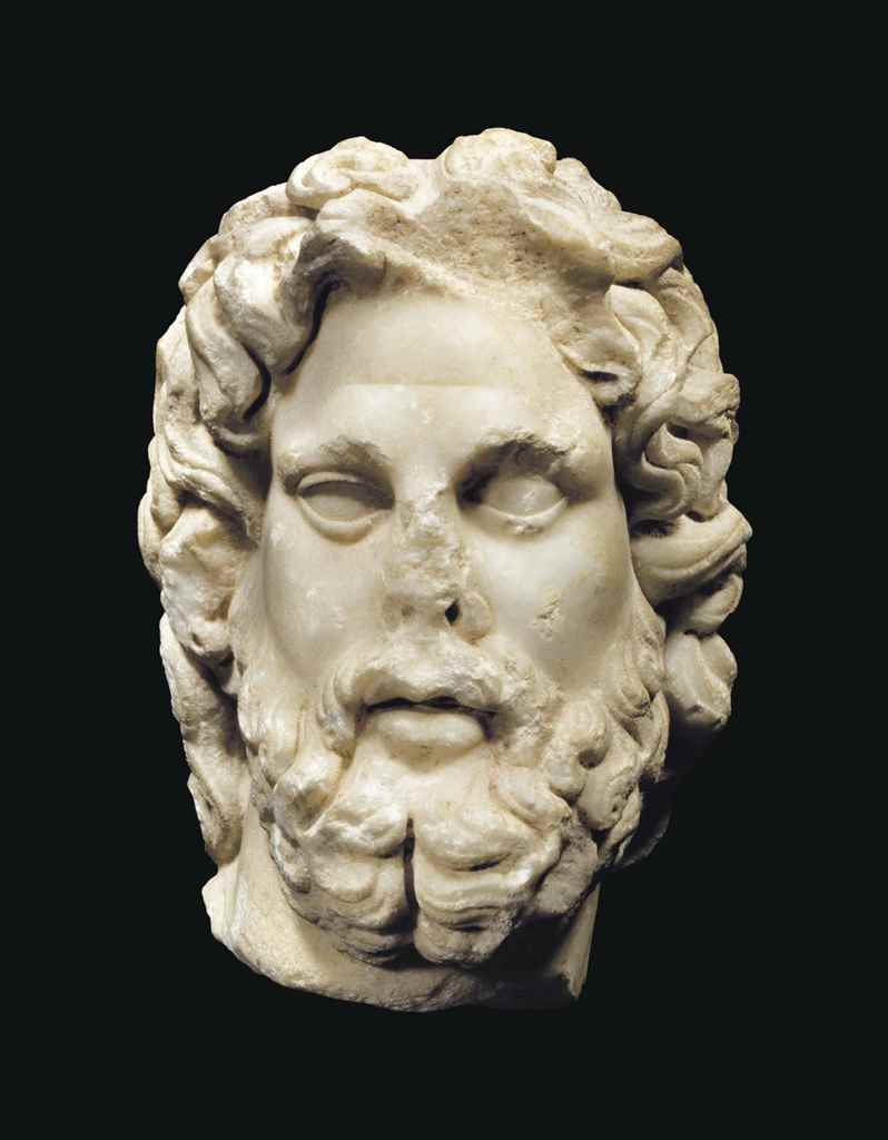 A ROMAN MARBLE HEAD OF ASCLEPI
