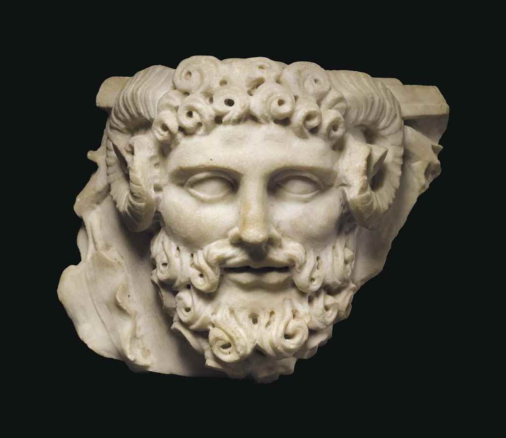 A ROMAN MARBLE HEAD OF JUPITER