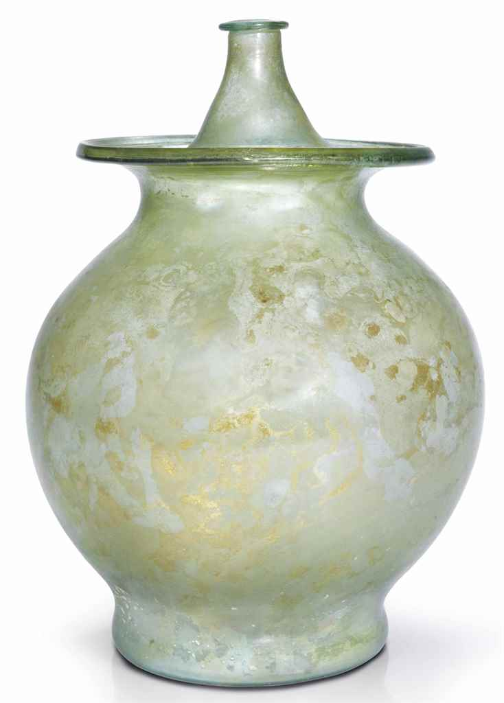 A ROMAN PALE GREEN GLASS LIDDE