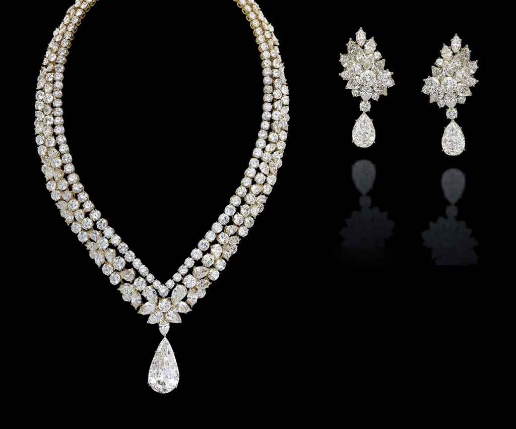 A SET OF DIAMOND JEWELLERY, BY