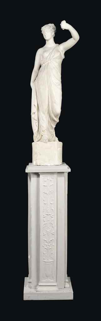 A VICTORIAN PLASTER FIGURAL TO
