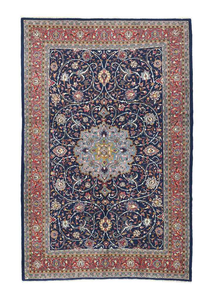 A SAROUK CARPET & SIGNED HEREK