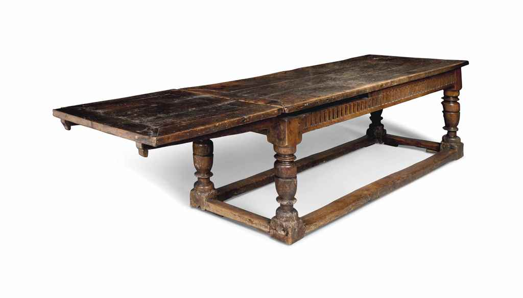 A JAMES I FIGURED-OAK ARCADED-