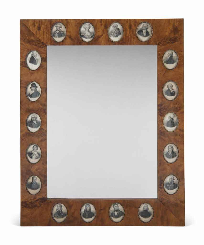A MAHOGANY MIRROR INSET WITH P