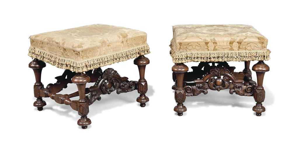 A PAIR OF LARGE CARVED WALNUT