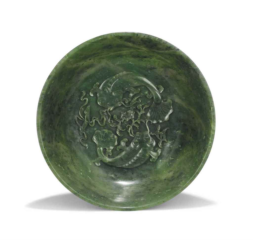 A CHINESE CARVED SPINACH JADE