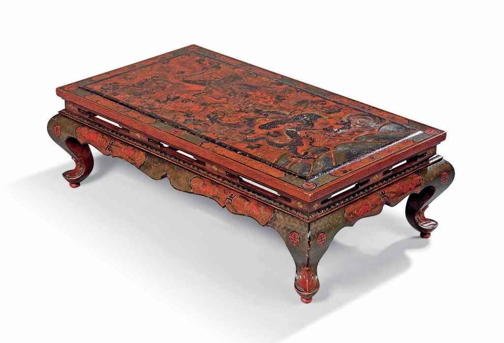 A CHINESE RED LACQUER LOW-TABL