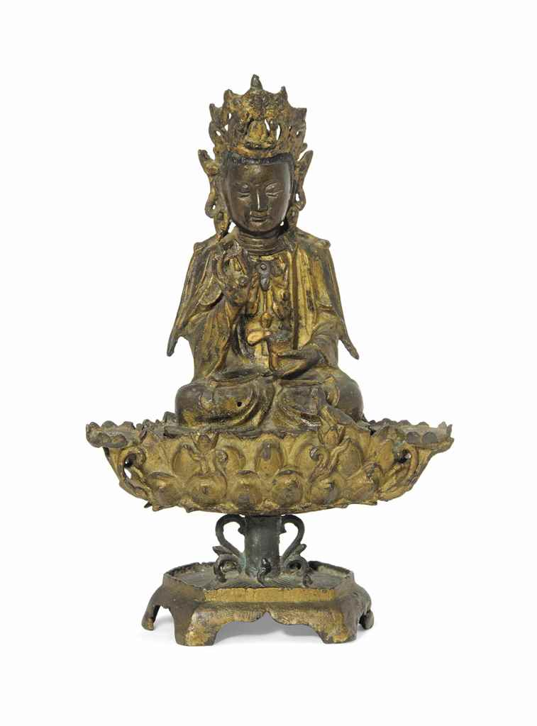 A GILT BRONZE FIGURE OF GUANYI