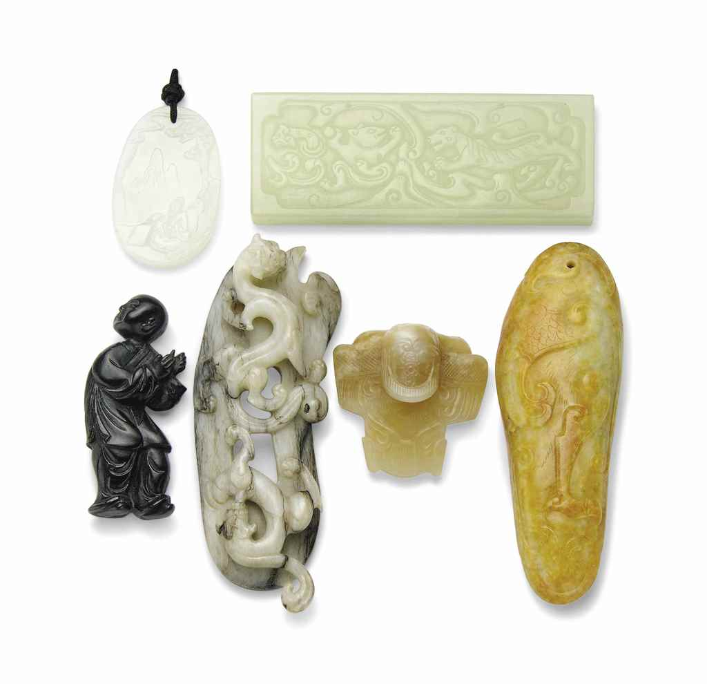 A GROUP OF SIX JADE CARVINGS