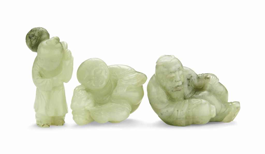 A GROUP OF THREE CELADON JADE