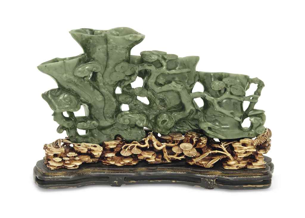 A SPINACH GREEN JADE CARVING