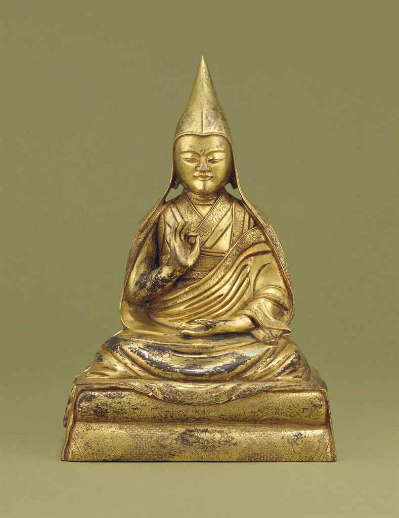 A GILT-BRONZE FIGURE OF A LAMA
