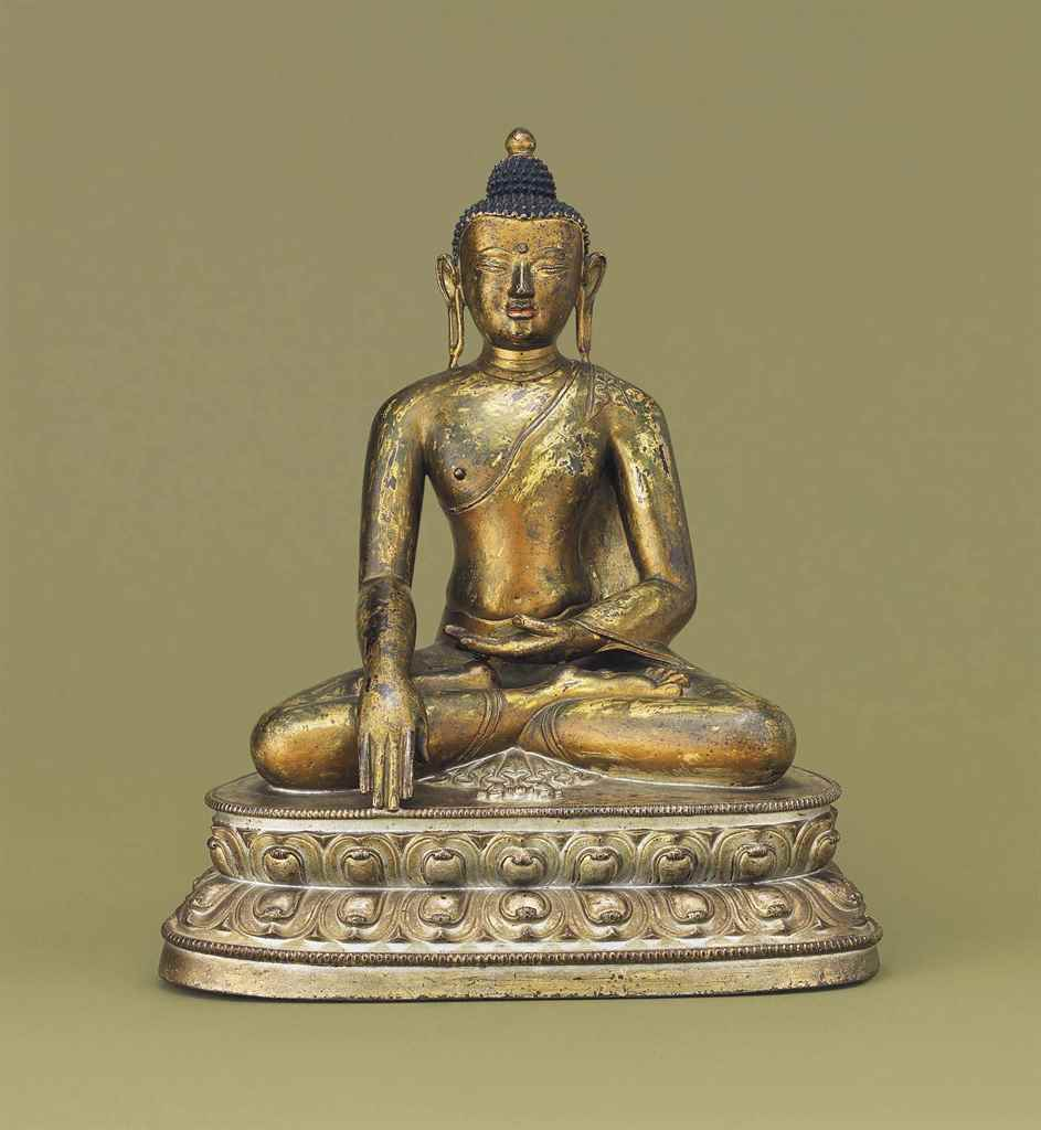 A GILT-BRONZE FIGURE OF SAKYAM