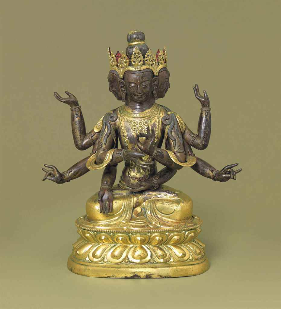 A GILT-BRONZE FIGURE OF USNISA