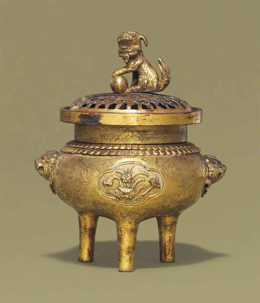 A GILT-COPPER TRIPOD CENSER AN