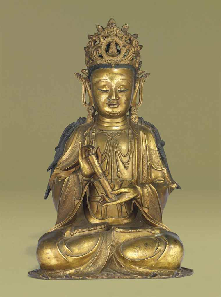 A RARE GILT-BRONZE FIGURE OF G