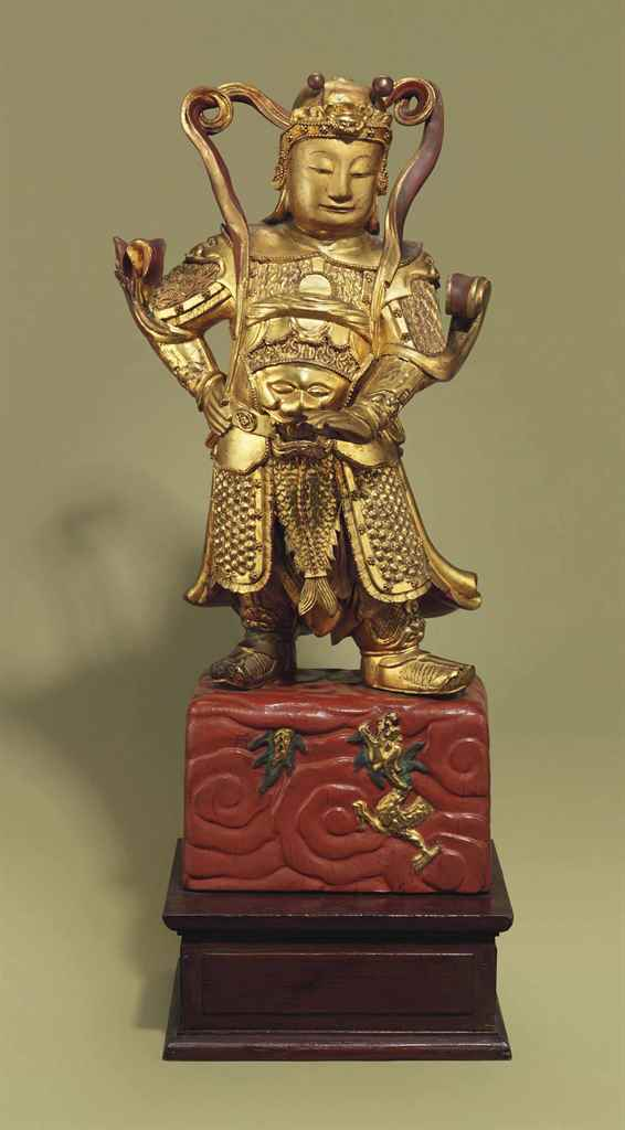 A RARE GILT-LACQUERED WOOD FIG