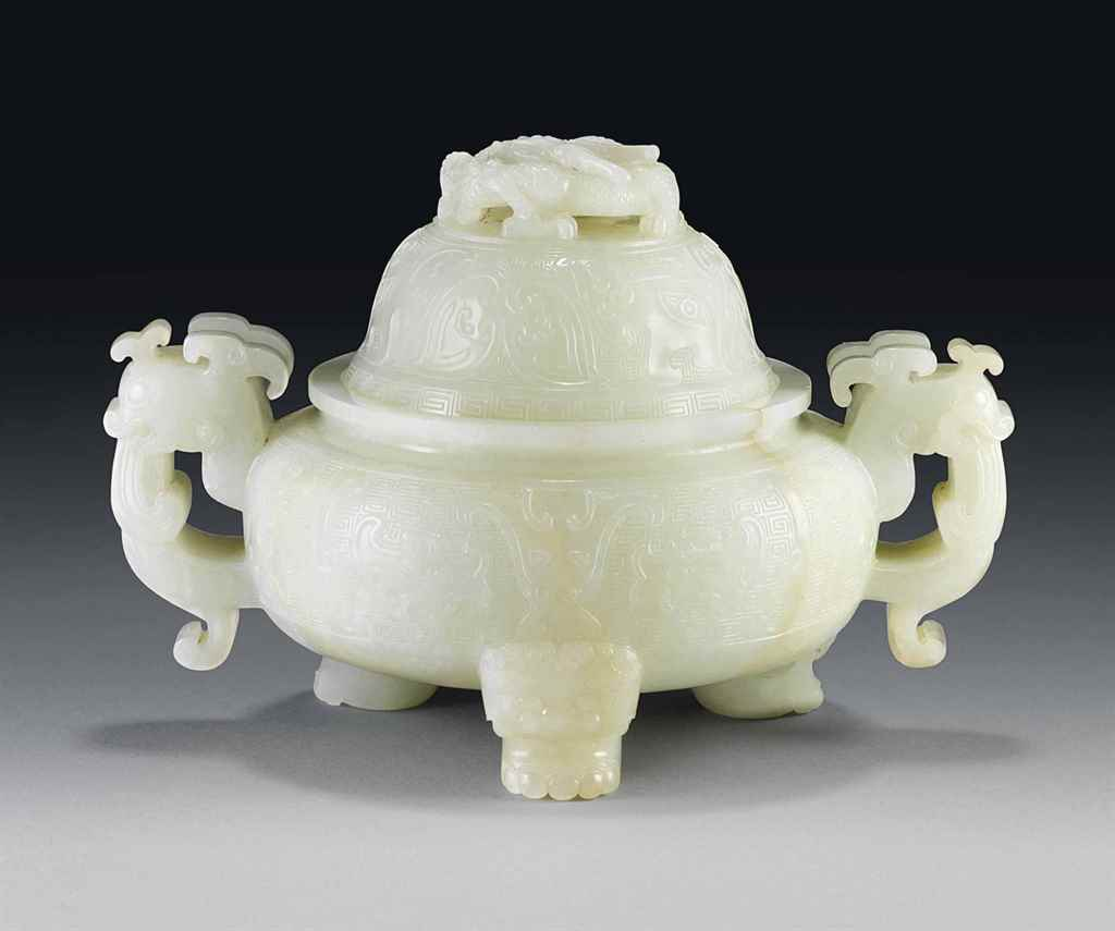 A WHITE JADE 'DRAGON' TWIN-HAN
