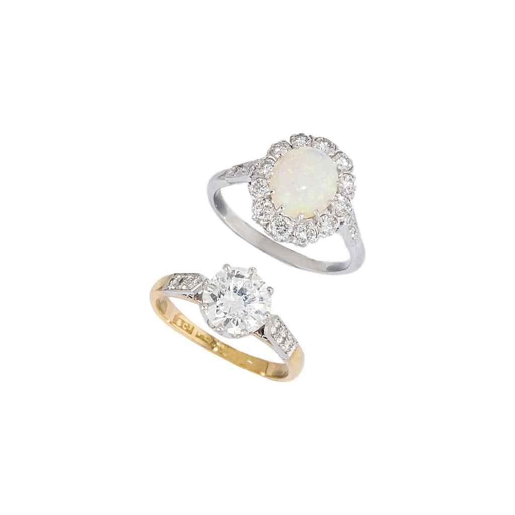FOUR DIAMOND-SET RINGS