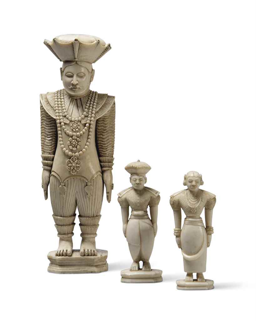 AN IVORY FIGURE OF A STANDING