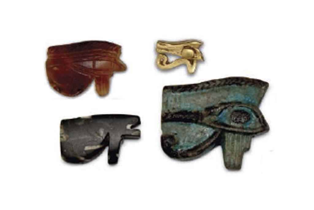FOUR WEDJET-EYE AMULETS