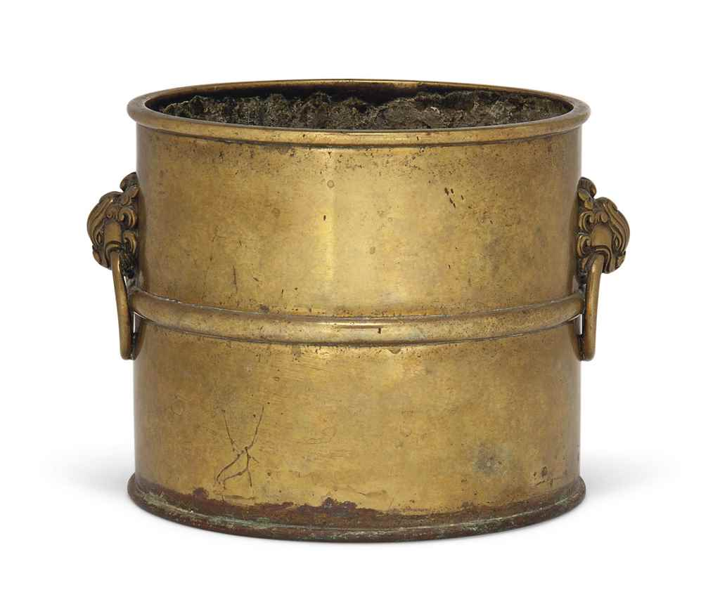 A BRONZE CYLINDRICAL BRUSH POT