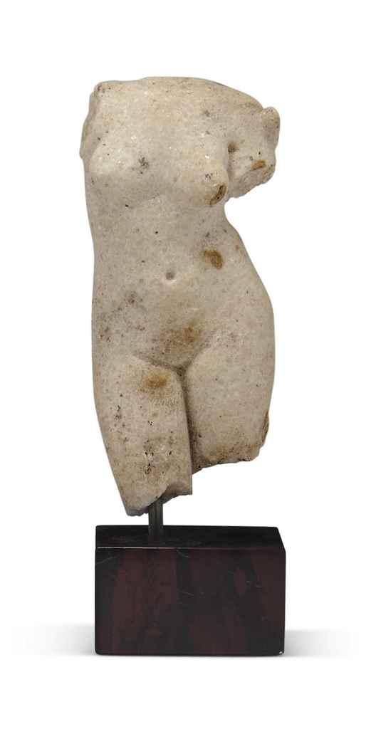 A MARBLE FEMALE TORSO