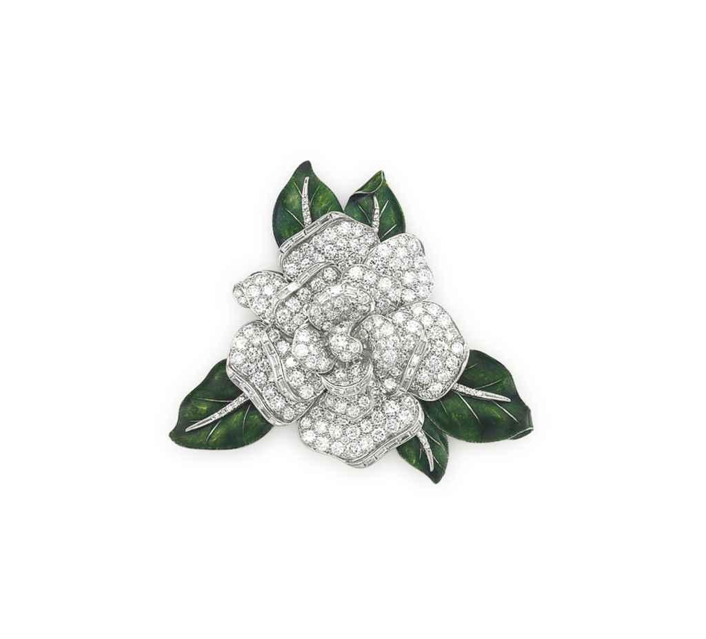 A DIAMOND AND ENAMEL 'GARDENIA