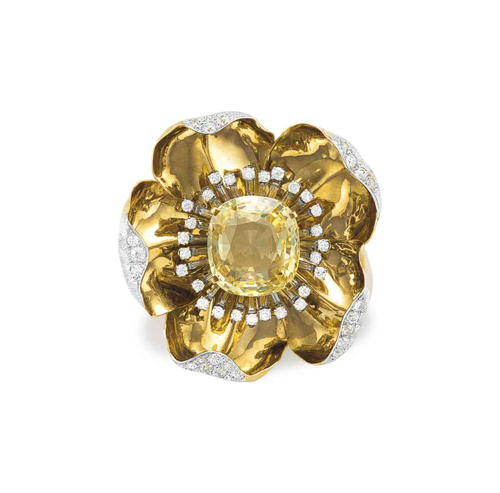 A COLORED SAPPHIRE, DIAMOND AN