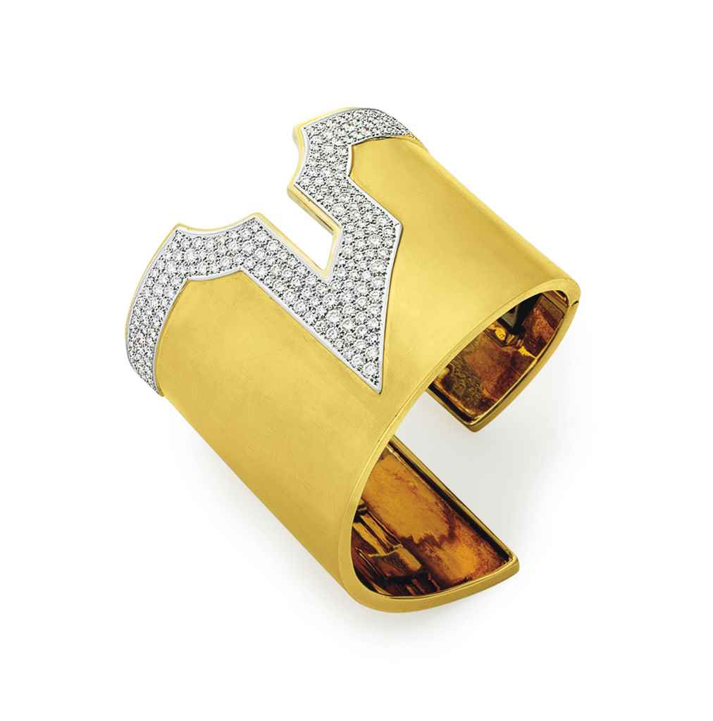 A DIAMOND AND GOLD CUFF BRACEL