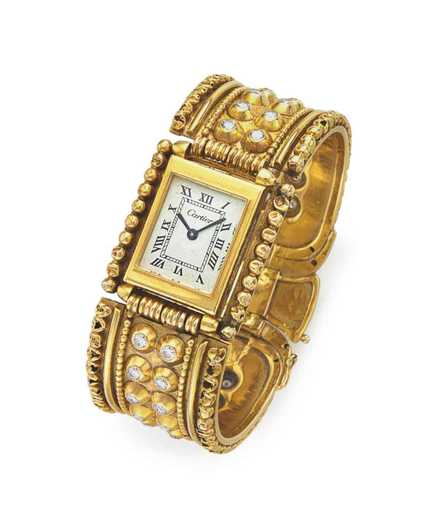A GOLD AND DIAMOND WATCH BRACE