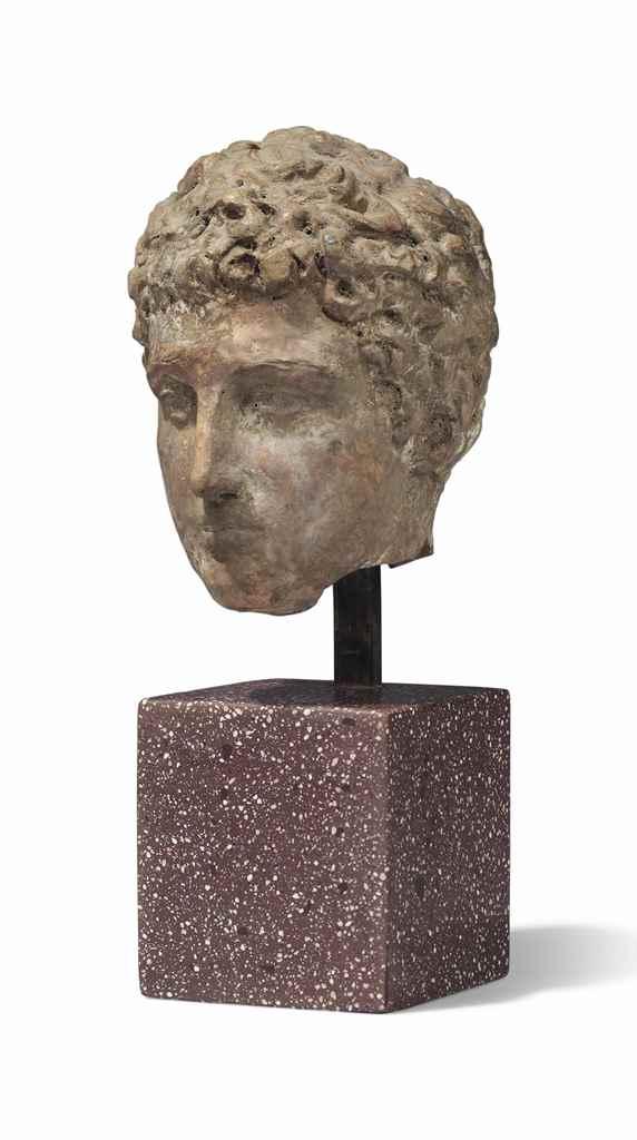 A GREEK TERRACOTTA HEAD OF A Y