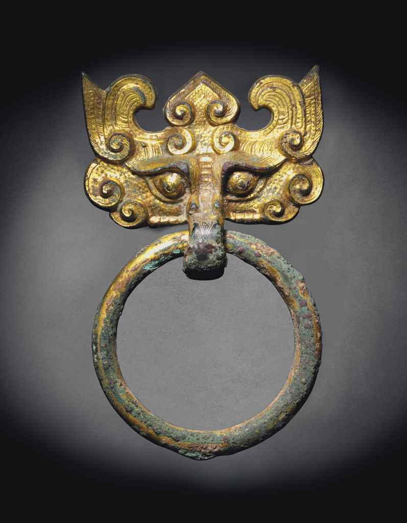 A GILT-BRONZE TAOTIE MASK FITT