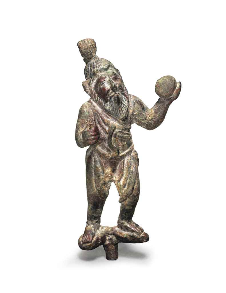 A RARE MINIATURE BRONZE FIGURE