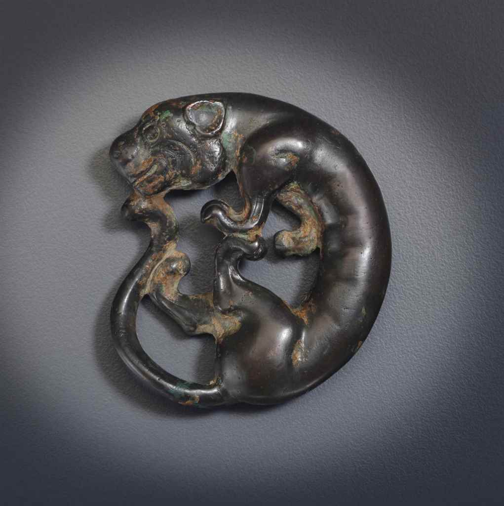 AN UNUSUAL BRONZE FELINE-FORM
