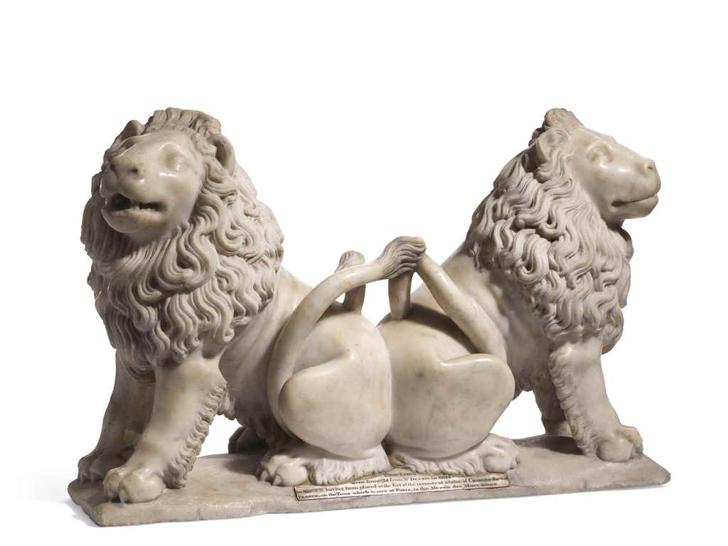 A CARVED MARBLE GROUP OF TWO A