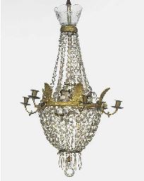 A gilt metal and glass six lig