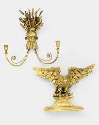A carved gilt wood eagle crest