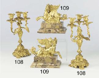 A pair of gilt metal three bra
