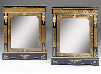 A pair of ebonised, brass and